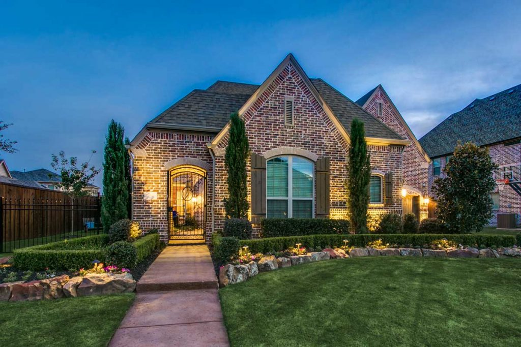 House lighting in the dark with landscaping