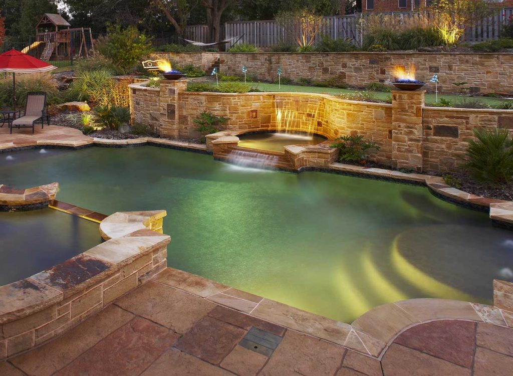 poolscapes with lighting and firepit